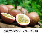 passion fruit on wooden table. | Shutterstock . vector #728325013