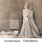 Small photo of BARCELONA, SPAIN - APRIL 18, 2015: A scene on the Passion Facade of the Sagrada Familia portrays Judas kissing Jesus. The numbers in the Subirachs Magic Square allude to the age of Jesus (33) then.