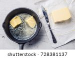 pieces of butter in the hot pan ... | Shutterstock . vector #728381137