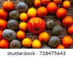 Small photo of Pumpkin Orange Attached Haybale Closeup Background Texture Decoration Autumn Fall Swirl Pattern