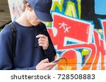 young man in a cap with a... | Shutterstock . vector #728508883