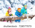 kids playing in snow.  | Shutterstock . vector #728577073