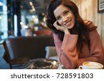 woman drinking coffee in a cafe | Shutterstock . vector #728591803