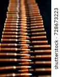 Small photo of ammo for semi-auto guns and automatic weapons lined up with symmetry
