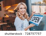 beautiful cafe owner in apron... | Shutterstock . vector #728757757