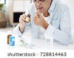 old man taking a pill | Shutterstock . vector #728814463