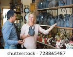 Small photo of Couple shopping kitchen-ware in workshop