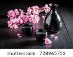 unfiltered white sake on black... | Shutterstock . vector #728965753