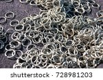 Small photo of Rings for crafting ring mail on the table with the sun