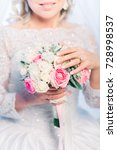 bride holding wedding bouquet | Shutterstock . vector #728998537