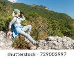 a blond woman tourist looking... | Shutterstock . vector #729003997