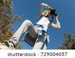a blond woman tourist looking... | Shutterstock . vector #729004057