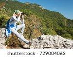 a blond woman tourist looking... | Shutterstock . vector #729004063