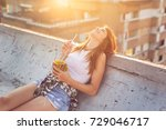 beautiful young woman lying on... | Shutterstock . vector #729046717