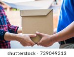 male hand accepting a delivery... | Shutterstock . vector #729049213