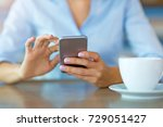 woman using mobile phone at... | Shutterstock . vector #729051427
