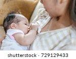 breastfeeding at home.   Shutterstock . vector #729129433