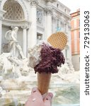 Small photo of Close up image of a gelato cone in front of the Trevi Fountain in Rome, Italy
