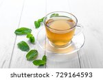 cup of mint tea on wooden table | Shutterstock . vector #729164593
