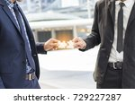 Small photo of Partners agree to do business together successfully,team work concept