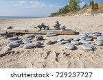 inukshuks on a board on an...   Shutterstock . vector #729237727