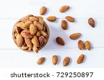 almonds in bowl on white wooden ... | Shutterstock . vector #729250897