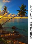 Stock photo excellent sunset view with a big stones and palmtrees seychelles la digue island 72942979