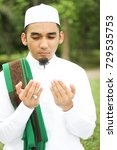 Small photo of Closeup shot of Muslim Man Recite Doa