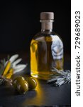 oil bottle with olives in dark...   Shutterstock . vector #729689023