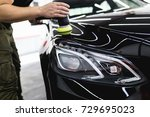 car detailing   hands with... | Shutterstock . vector #729695023