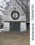 Small photo of barn with holiday wreath