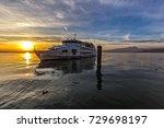 ferry leaves from lazise del... | Shutterstock . vector #729698197