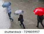 People Run In The Rainy Weathe...