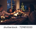family toasting with wine in a... | Shutterstock . vector #729853333