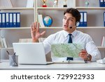 Small photo of Businessman operator traveling agent working in the office