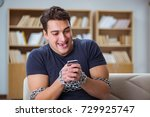 Small photo of Man suffering from phone dependence addiction