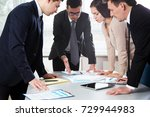 group of business people at a... | Shutterstock . vector #729944983