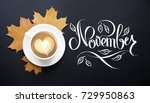 Small photo of A cup of coffee with cappuccino and autumn leaves composition. Autumn decor, fall mood, autumn still life with hand lettering November