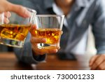 close up of two men clink... | Shutterstock . vector #730001233