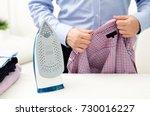man ironing shirt on ironing... | Shutterstock . vector #730016227