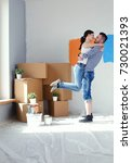 happy young couple moving in... | Shutterstock . vector #730021393