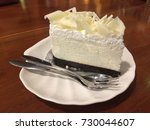 a slice of white chocolate cake