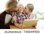 affectionate parents kissing... | Shutterstock . vector #730049503