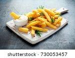 homemade baked potato fries... | Shutterstock . vector #730053457