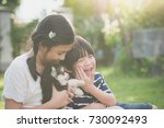 asian children playing with... | Shutterstock . vector #730092493