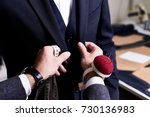 closeup of tailor fitting... | Shutterstock . vector #730136983