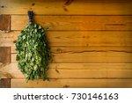 birch brooms on a wooden wall... | Shutterstock . vector #730146163
