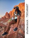 woman taking a break from... | Shutterstock . vector #730168687