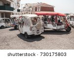 Small photo of Lisbon, Portugal - August 13, 2017: Tuk Tuk taxi cabs of Lisbon stand on a city square with tourists as a passengers. Piaggio Ape three-wheeled light commercial vehicles produced since 1948 by Piaggio