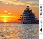 Small photo of Luxury yacht at sunset. Yachting. Cruises